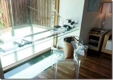 Conrad Rangali desk glass floor