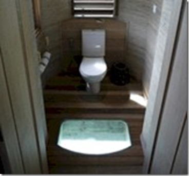 Four Seasons Landaa Giraavaru glass floor toilet