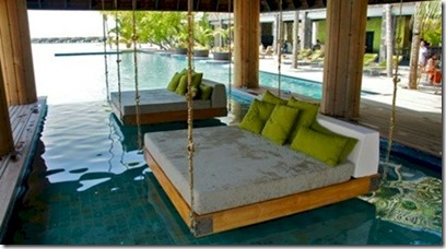 Anantara Kihavah Villas - pool swings