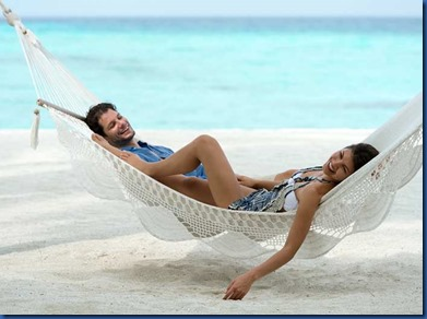 Chill out in a hammock on the beach and enjoy the pleasure of sharing this special moment together